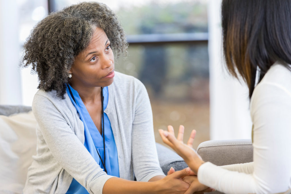 Counselor listens to client
