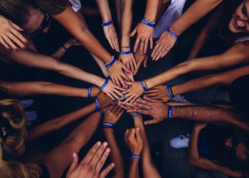 Hands joined in circle of support