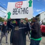 Keep Breathing protest sign