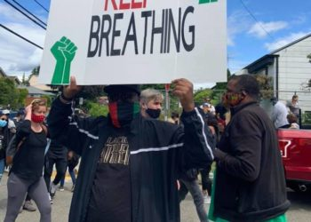 Keep Breathing protest sign - Community Support