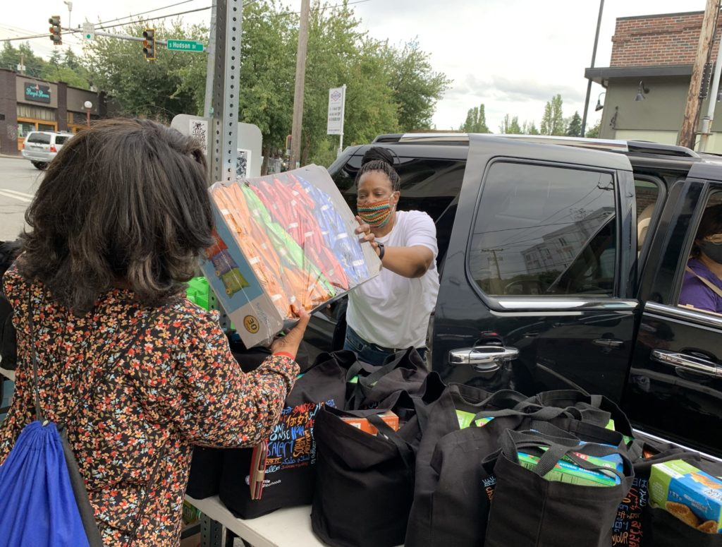 FAST volunteers load car with family care package